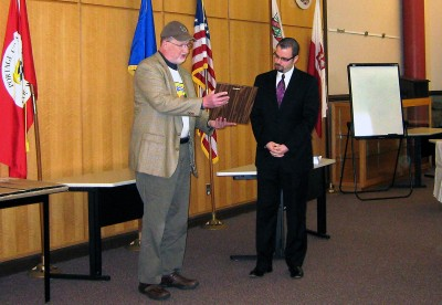 December 2, 2010. Carl Schwartz, founding director of Bird City Wisconsin, presents recognition award to Andrew Halverson, then mayor of Stevens Point, one of the state's initial 10 Bird City Wisconsin communities.